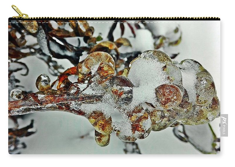 Winter Carry-all Pouch featuring the photograph Flower Icicle. by Olga Vlasova