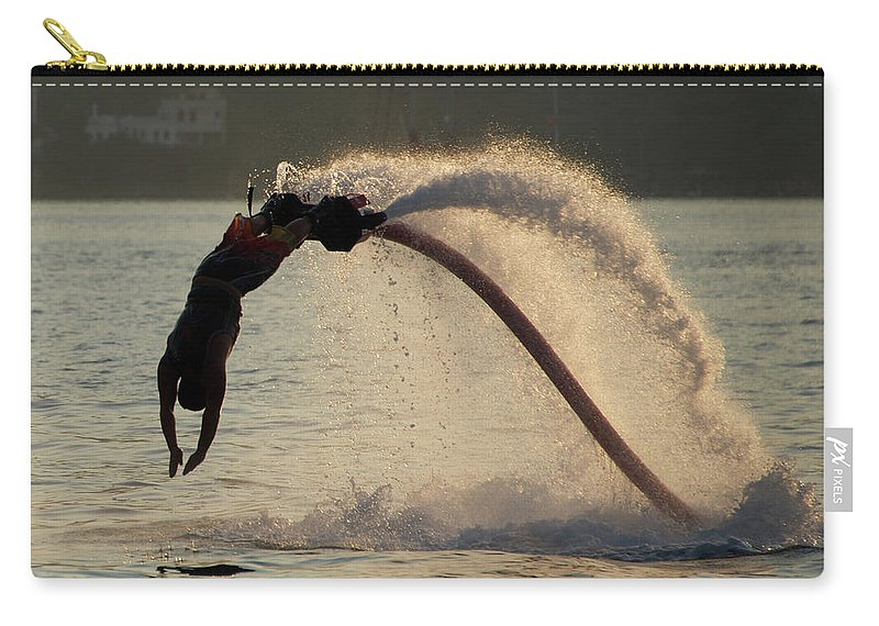 Bodrum Carry-all Pouch featuring the photograph Flyboarder About To Enter Water With Hands by Ndp