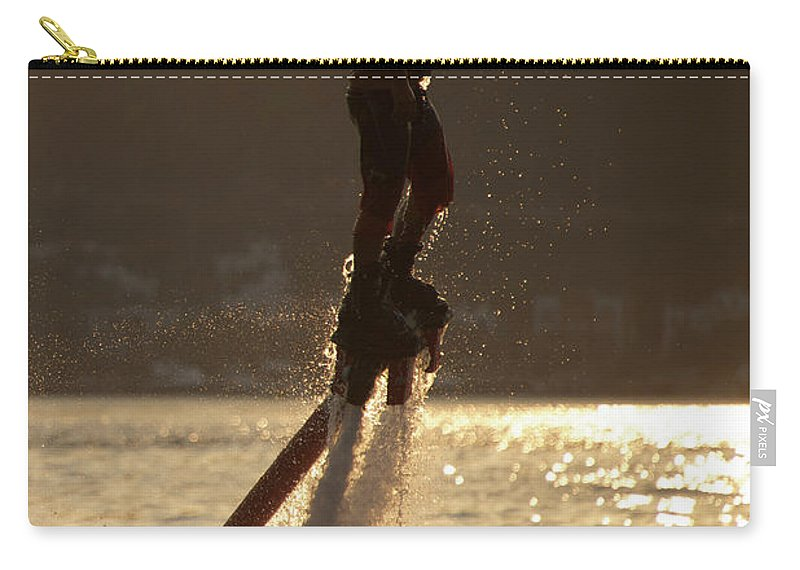 Bodrum Carry-all Pouch featuring the photograph Flyboarder And Water Droplets Backlit At Sunset by Ndp