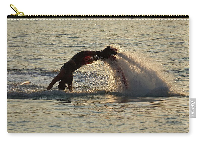 Bodrum Carry-all Pouch featuring the photograph Flyboarder Diving In Up To His Arms by Ndp