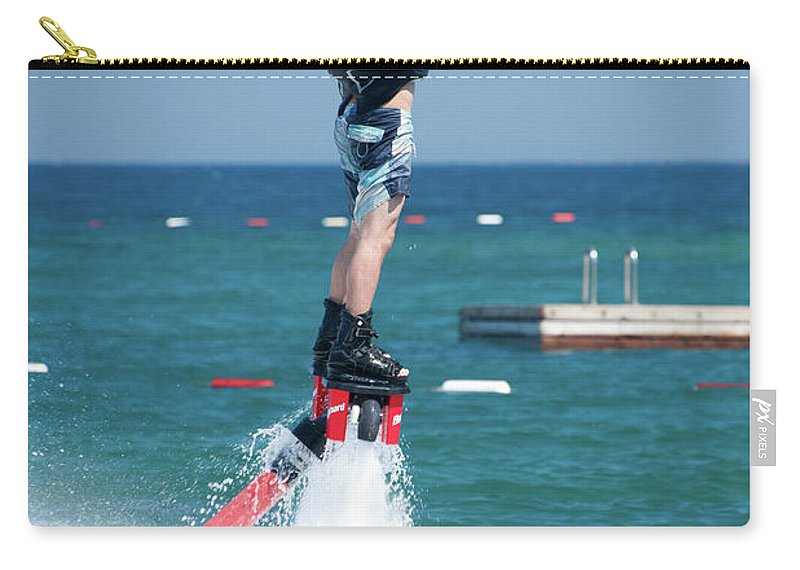 Bodrum Carry-all Pouch featuring the photograph Flyboarder Falling Backwards Next To Swimming Platform by Ndp