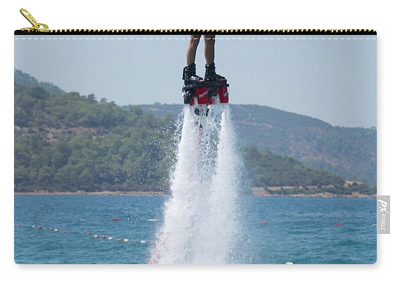 Bodrum Carry-all Pouch featuring the photograph Flyboarder Giving Victory Sign With One Hand by Ndp