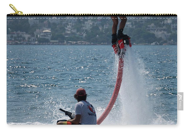 Bodrum Carry-all Pouch featuring the photograph Flyboarder In Pink Shorts Above Jet Ski by Ndp