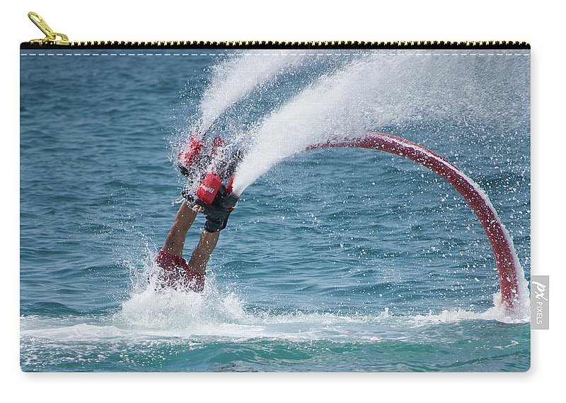 Bodrum Carry-all Pouch featuring the photograph Flyboarder In Red Entering Water With Spray by Ndp
