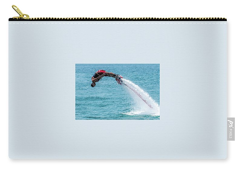 Bodrum Carry-all Pouch featuring the photograph Flyboarder In Red Followed By Water Jet by Ndp