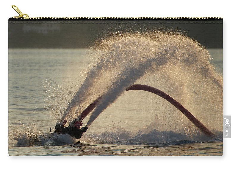 Bodrum Carry-all Pouch featuring the photograph Flyboarder Only Showing Feet After Semi-circular Dive by Ndp