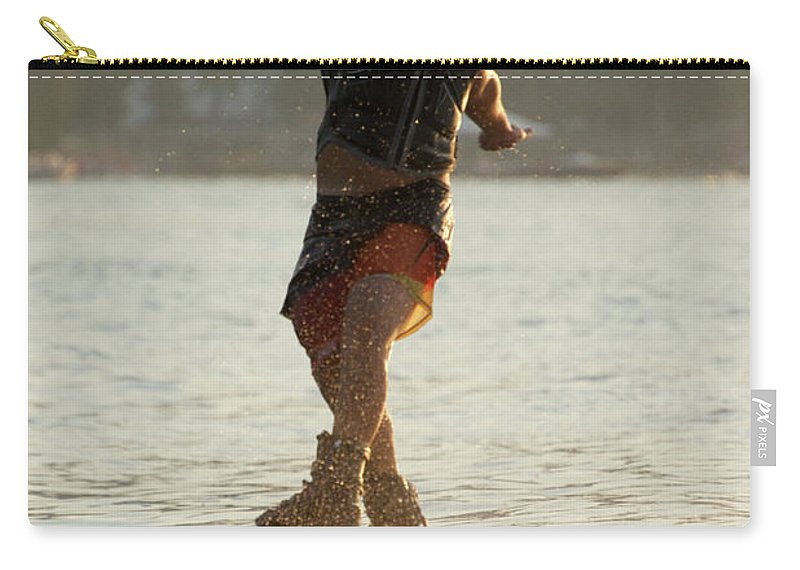 Bodrum Carry-all Pouch featuring the photograph Flyboarder Twisting Upper Body Just Above Waves by Ndp