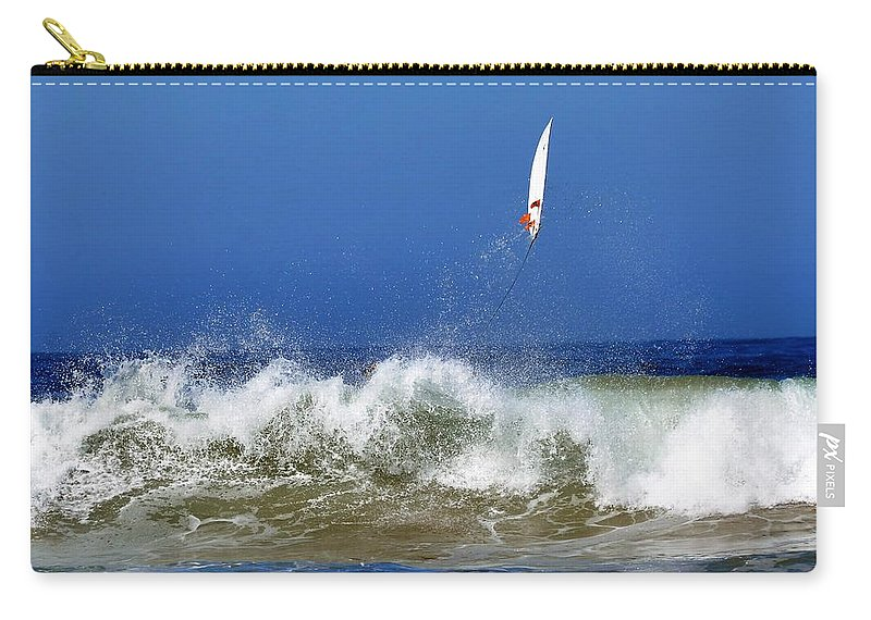 Surfer Carry-all Pouch featuring the photograph Flying by Michael Brown
