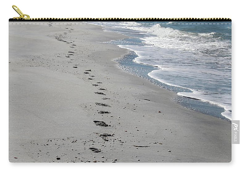 Footsprints Carry-all Pouch featuring the photograph Footsprints In The Sand by Christiane Schulze Art And Photography