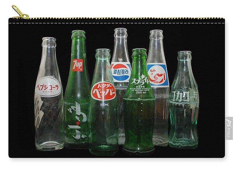 Pepsi Carry-all Pouch featuring the photograph Foreign Cola Bottles by Rob Hans
