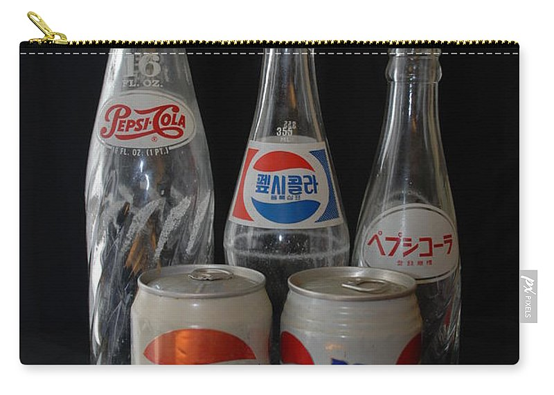 Arabic Carry-all Pouch featuring the photograph Foriegn Colas by Rob Hans