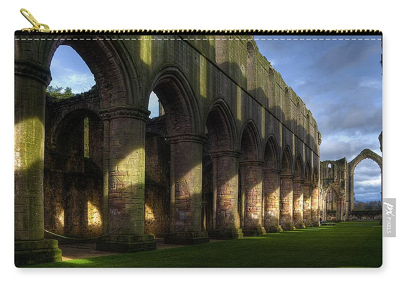 Castle Carry-all Pouch featuring the photograph Fountains Abbey Shadows by Svetlana Sewell