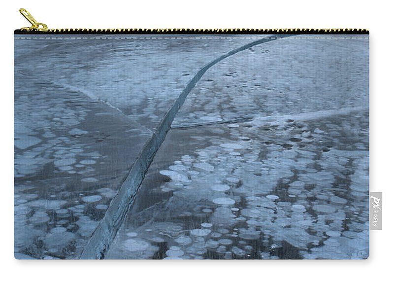 Abraham Lake Carry-all Pouch featuring the photograph Fracture Through The Bubbles by Adam Jewell