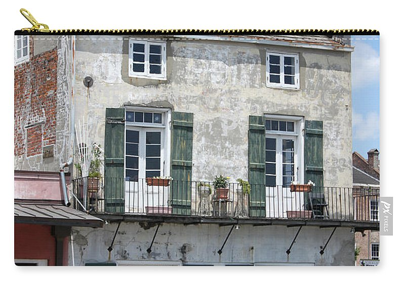 Architecture Carry-all Pouch featuring the photograph French Market Cafe by Todd Blanchard