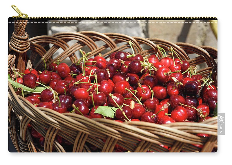 Fresh Carry-all Pouch featuring the photograph Fresh Picked Cherries In A Wicker Basket In Dolnje Cerovo In The by Reimar Gaertner