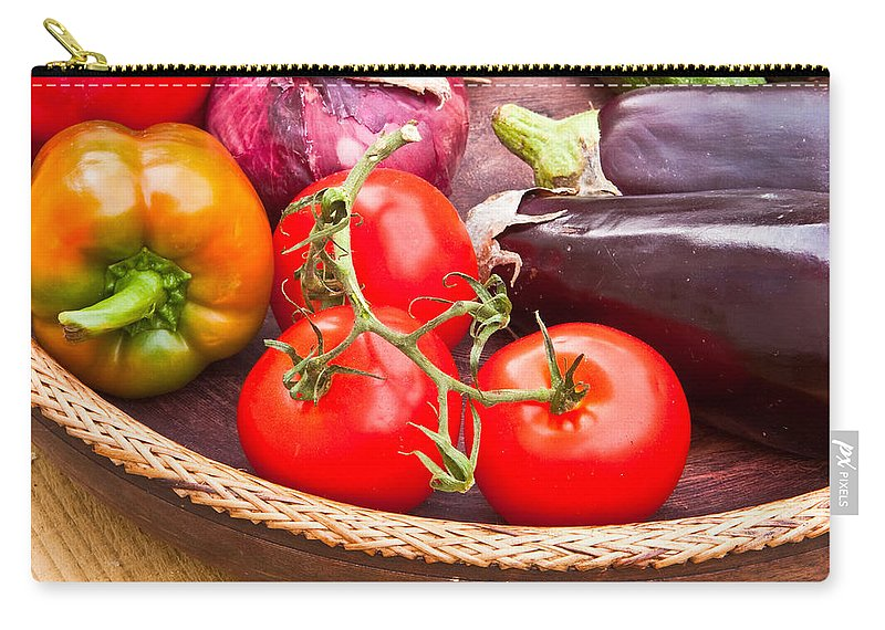 Aubergine Carry-all Pouch featuring the photograph Fruit And Vegetables by Tom Gowanlock