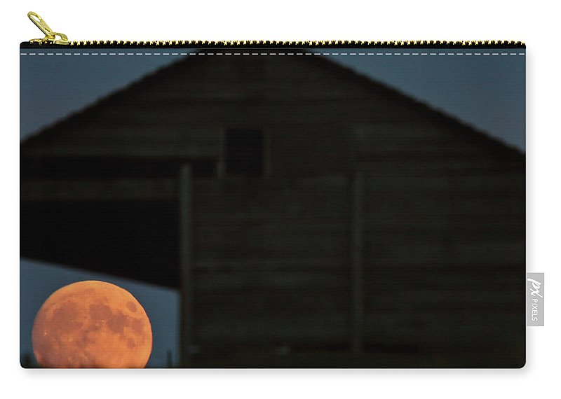 Building Carry-all Pouch featuring the digital art Full Moon Seen Through Old Building Window by Mark Duffy