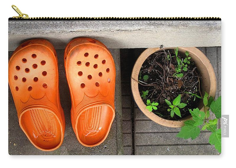 Clogs Carry-all Pouch featuring the photograph Garden Shoes by Ian MacDonald