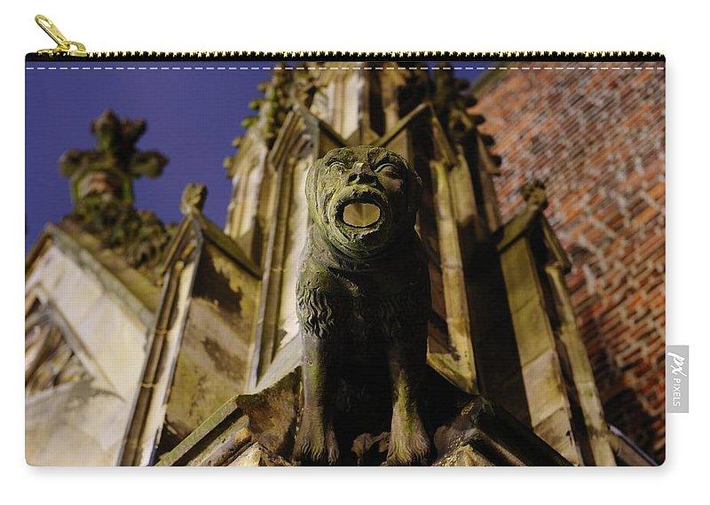 Gargoyle Carry-all Pouch featuring the photograph Gargoyle At The Dom Church In Utrecht In The Evening 188 by Merijn Van der Vliet