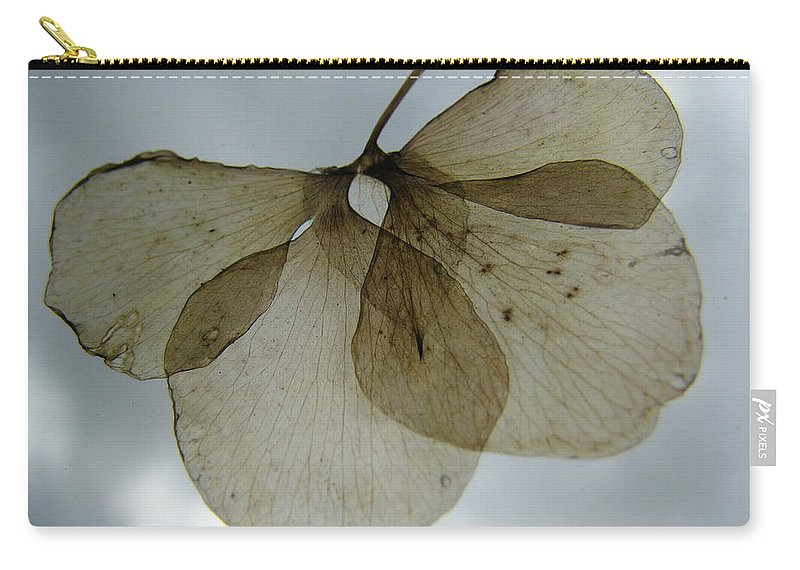 Ghostlike Carry-all Pouch featuring the photograph Ghost Of A Flower by Mary Ellen Mueller Legault