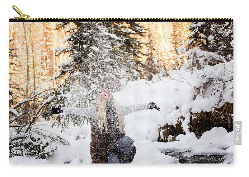 Travel Carry-all Pouch featuring the photograph Girl Playing In The Snow In The Woods by Tamara Kirsanova