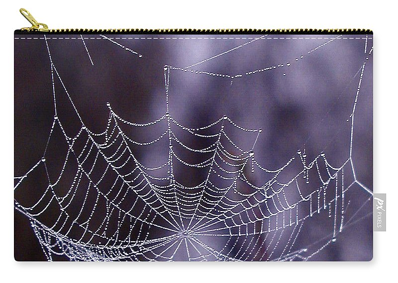 Web Carry-all Pouch featuring the photograph Glistening Web by Karol Livote