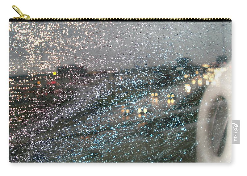 Usha Carry-all Pouch featuring the photograph Glowing Raindrops In The City by Usha Shantharam