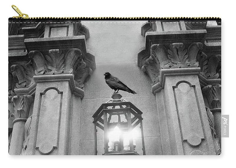 Raven Crow Art Carry-all Pouch featuring the photograph Gothic Surreal Black White Raven On Lantern Lamp Post by Kathy Fornal