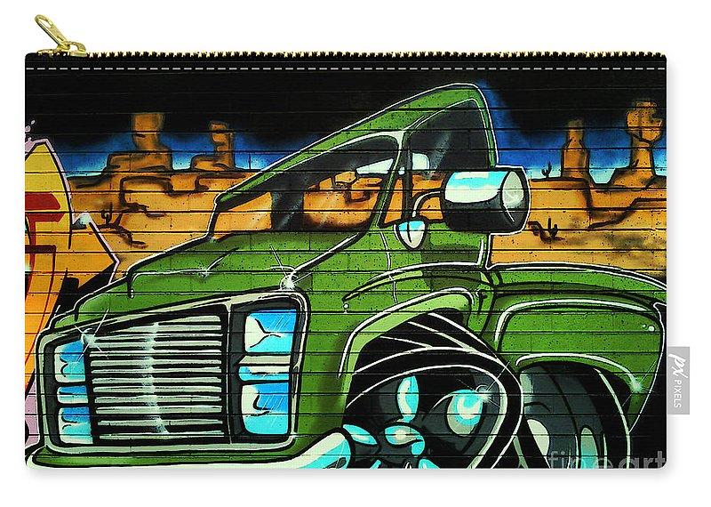 Graffiti Carry-all Pouch featuring the photograph Graffiti 10 by Ben Yassa