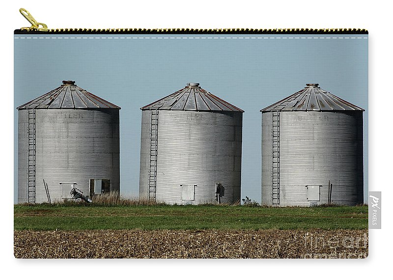 Agriculture Carry-all Pouch featuring the photograph Grain Bins In A Row by Alan Look