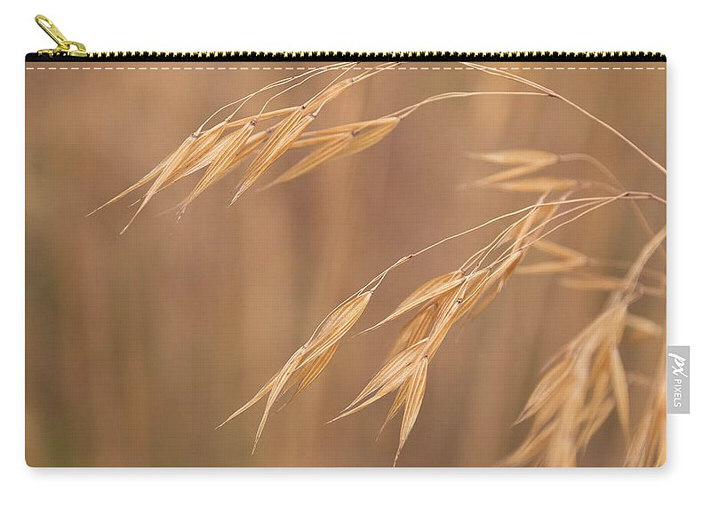 Stipa Carry-all Pouch featuring the photograph Grass In The Wind by Monika Tymanowska