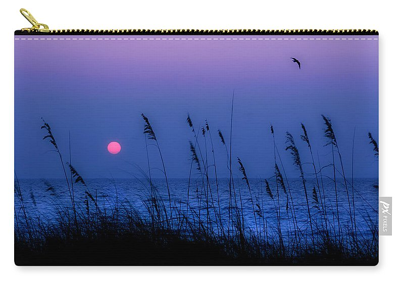 Grass Carry-all Pouch featuring the photograph Grasses Frame The Setting Sun In Florida by Mal Bray