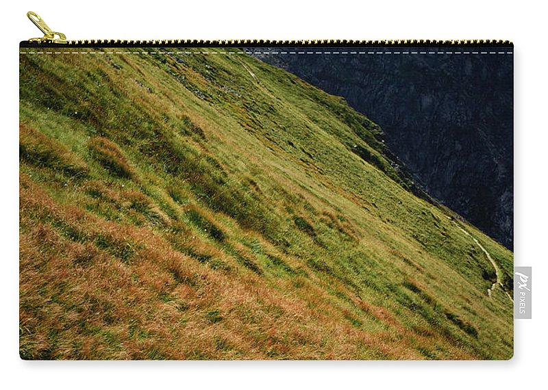 Dark Carry-all Pouch featuring the photograph Grassy Before The Top Of The Rocky Hill by Jozef Jankola