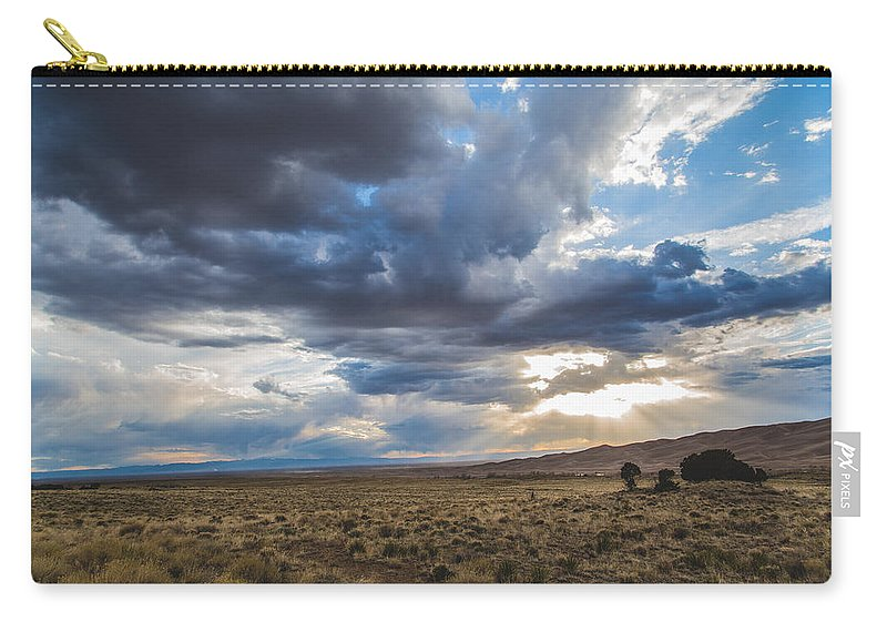 Clouds Carry-all Pouch featuring the photograph Great Sand Dunes Stormbreak by Jason Roberts