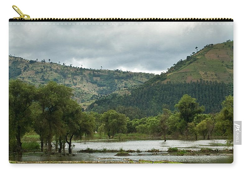 Guatemala Carry-all Pouch featuring the photograph Guatemalan Nursery And Lake by Douglas Barnett