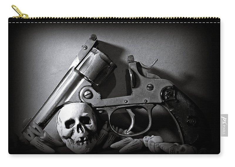 Black And White Carry-all Pouch featuring the photograph Gun And Skull by Scott Wyatt