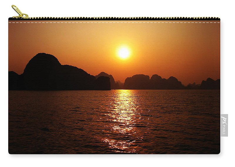 Orange Carry-all Pouch featuring the photograph Ha Long Bay Sunset by Oliver Johnston