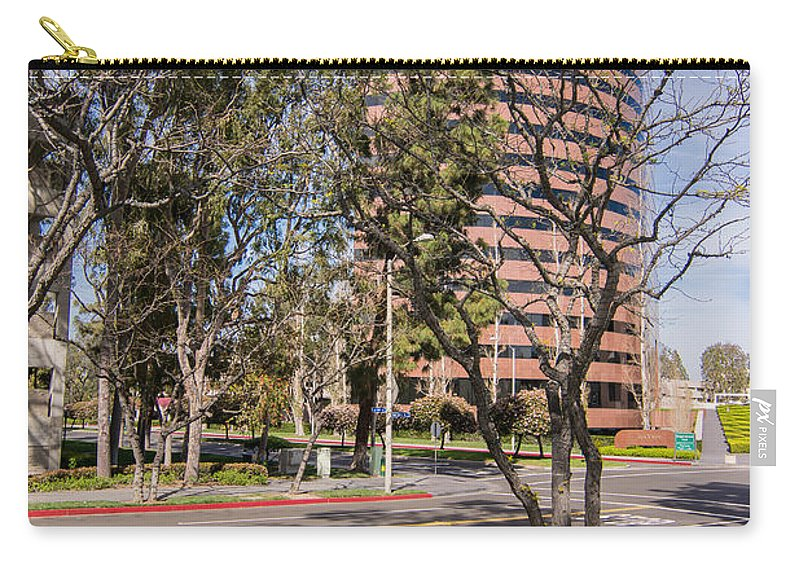 Building Carry-all Pouch featuring the photograph Half Circle Building by Robert VanDerWal