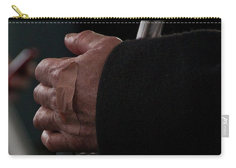Hand Carry-all Pouch featuring the photograph Hand With Bandaid by Steven Natanson