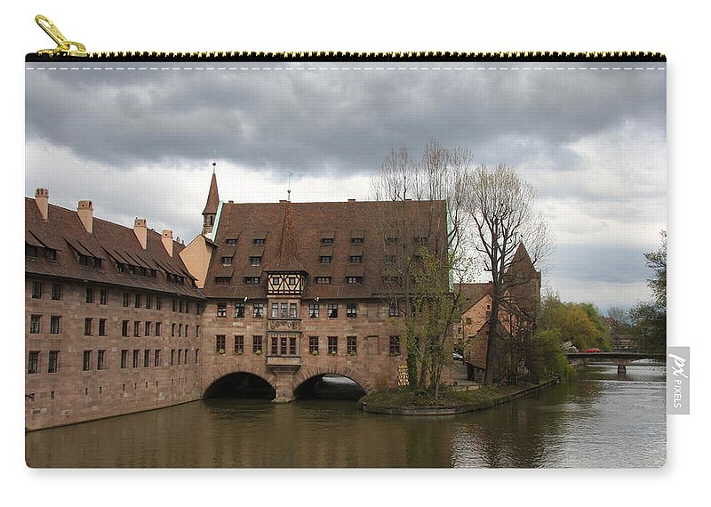 Asylum Carry-all Pouch featuring the photograph Heilig Geist Spital - Nuremberg by Christiane Schulze Art And Photography