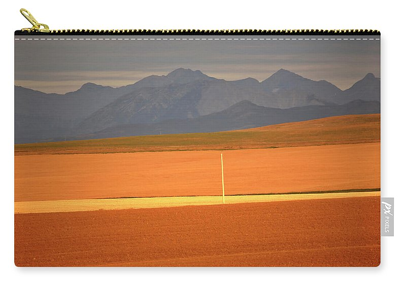 Sunlit Carry-all Pouch featuring the digital art High Plains Of Alberta With Rocky Mountains In Distance by Mark Duffy