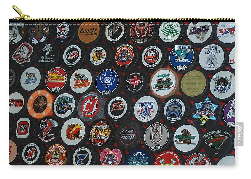 Pop Art Carry-all Pouch featuring the photograph Hockey Pucks by Rob Hans