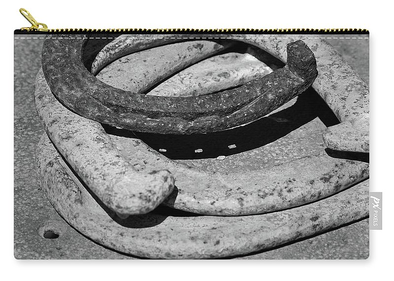 Horse Carry-all Pouch featuring the photograph Horse Shoes by Andrei Shliakhau