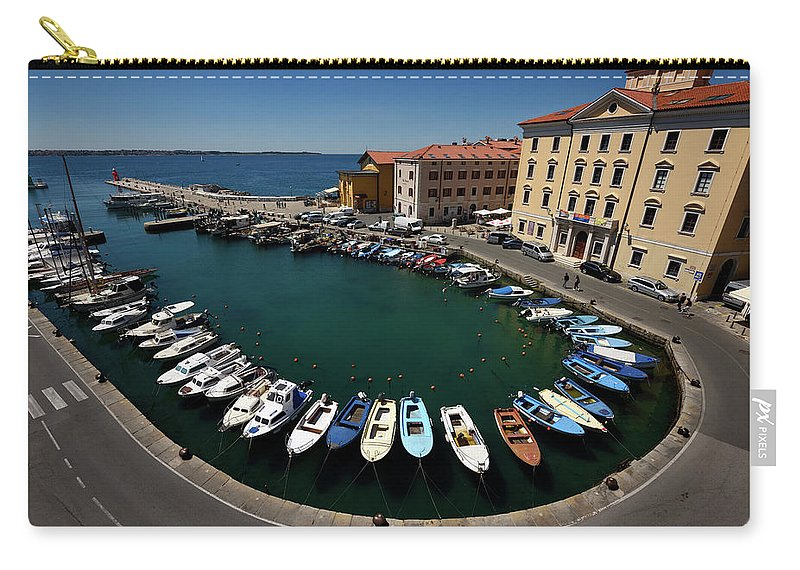 Horseshoe Carry-all Pouch featuring the photograph Horseshoe Pattern Of Moored Boats At The Inner Harbour Of Piran by Reimar Gaertner