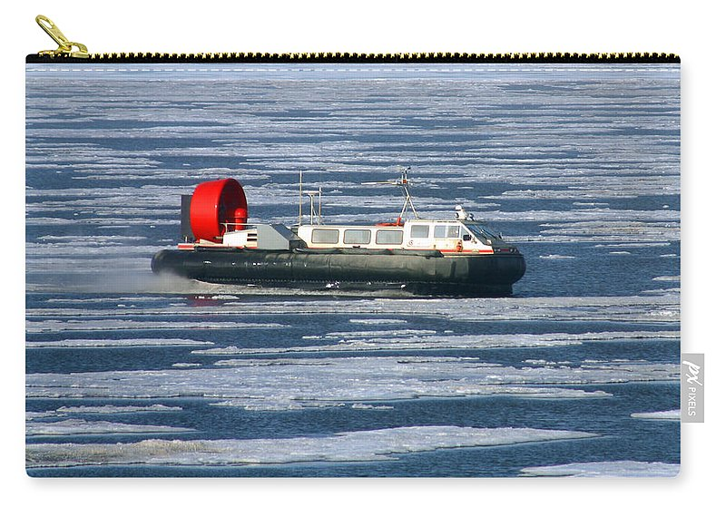 Arctic Ocean Carry-all Pouch featuring the photograph Hovercraft On Frozen Artic Ocean by Anthony Jones