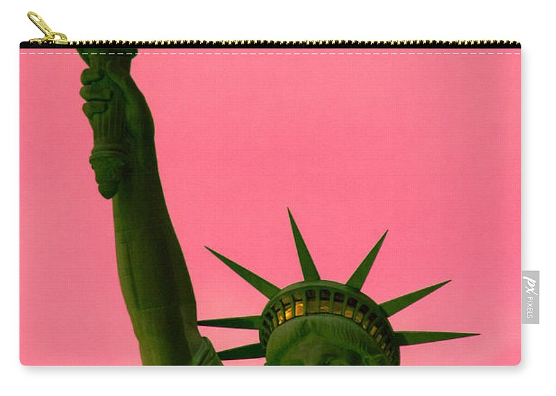 Architecture Carry-all Pouch featuring the photograph How Long Will This Light Burn by Michael Goodin