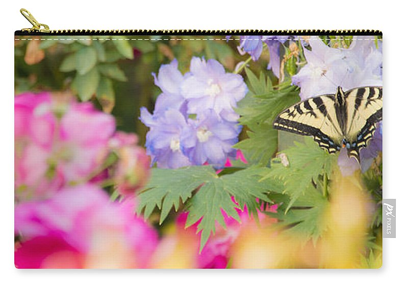 Flowers Carry-all Pouch featuring the photograph In The Garden by Don Edward Jones