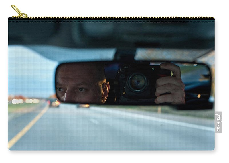 Driving Carry-all Pouch featuring the photograph In The Road by Steven Dunn
