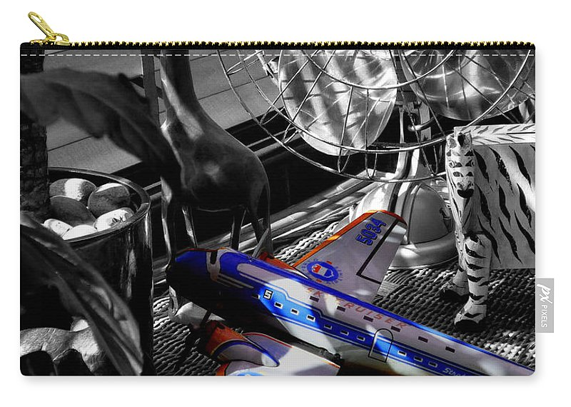 Fan Carry-all Pouch featuring the photograph Indiana Jones And The Jungle Dream by Charles Stuart