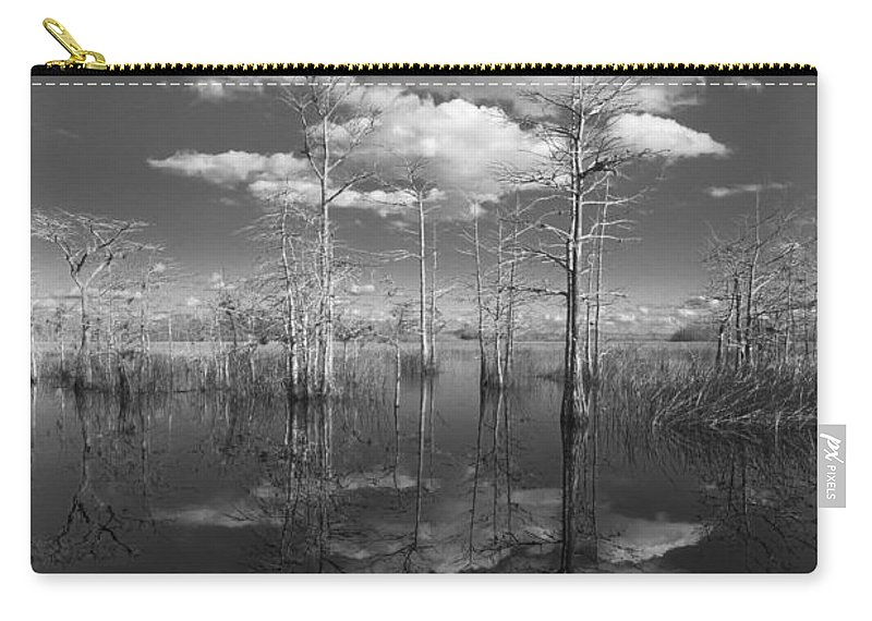 Clouds Carry-all Pouch featuring the photograph Into The Everglades by Debra and Dave Vanderlaan